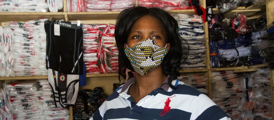 A trader puts on a face mask to prevent the spread of COVID-19 between her and customers at Konyo-konyo market in Juba. @UNICEFSouthSudan/Chol
