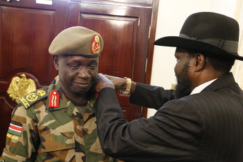 Photo: Gen. James Ajongo being promoted by President Kiir before swearing in as new chief of general staff on May 10, 2017. (Radio Tamazuj)