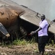 People stand near the cargo plane that crashed in Juba shortly after takeoff [David Dhal Malual/AFP]